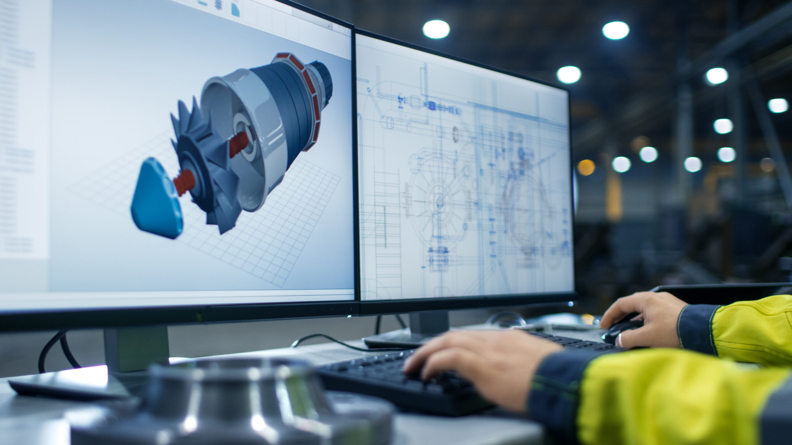 Inside the Heavy Industry Factory Close-up Footage of  Industrial Engineer's Hands Working on the Personal Computer with Two Monitors Designing Turbine/ Engine in 3D, Using CAD Program.