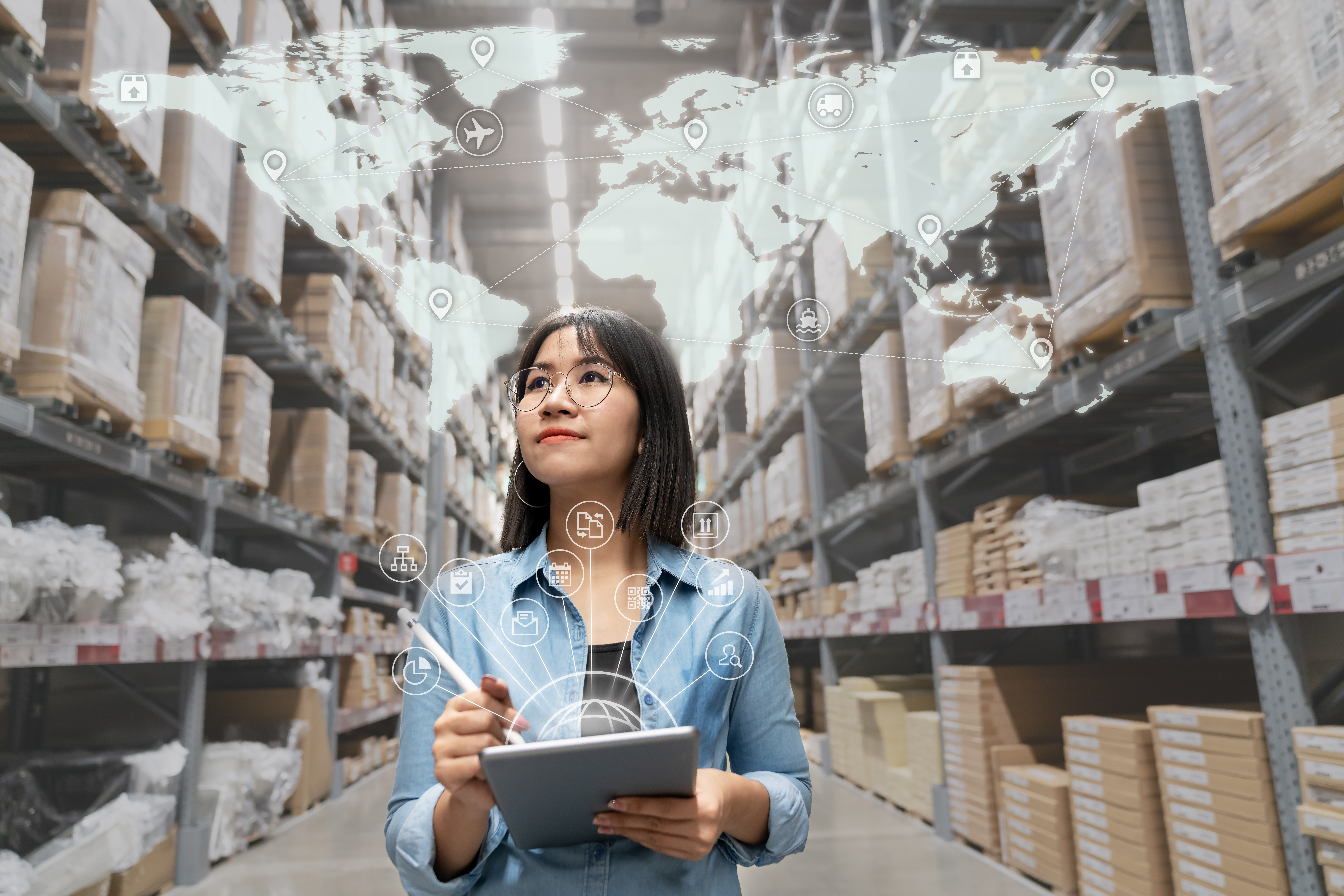 Portrait of happy young attractive asian entrepreneur woman looking at inventory in warehouse using smart tablet in management technology,  interconnected industry, asian small business sme concept.